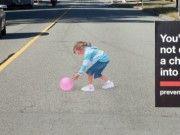 Girl Chasing Ball Across Street